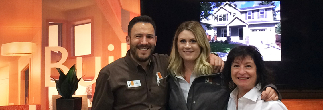 Professional remodelers work at a residential industry trade show