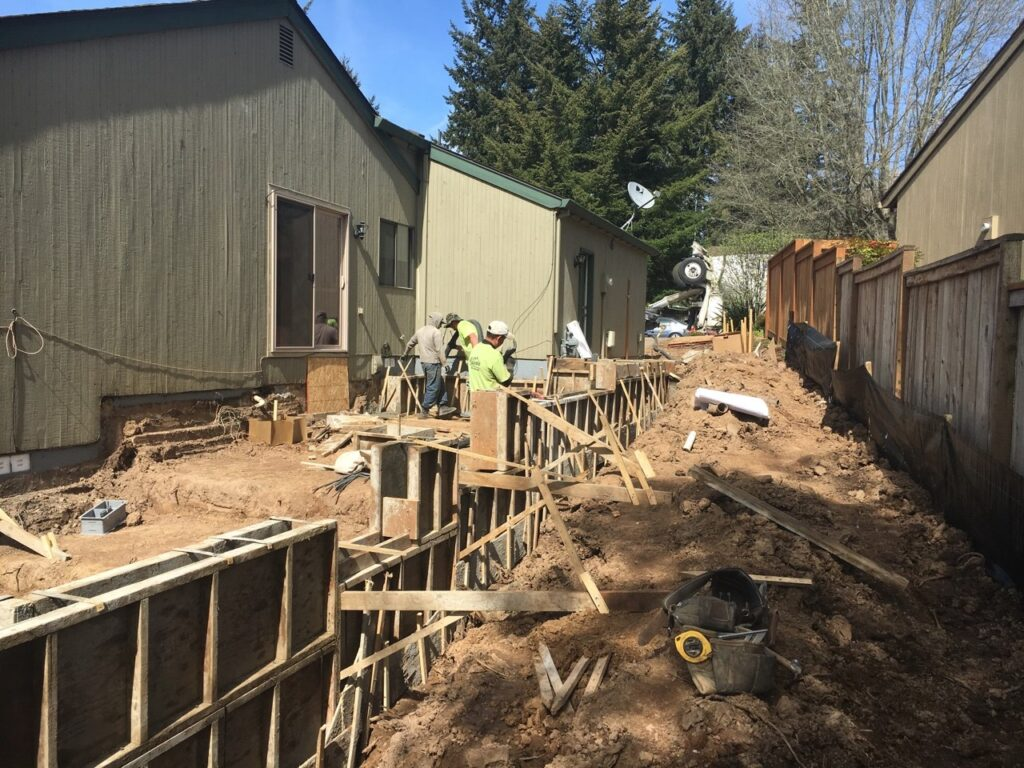 foundation walls being set for home addition