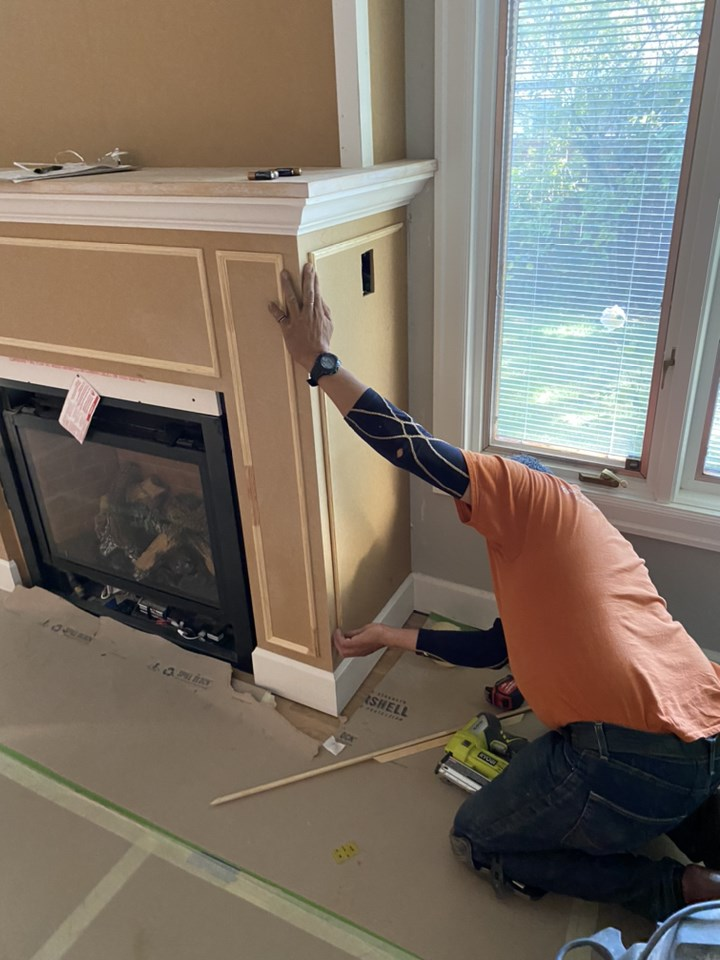 Gaspar with Mountainwood Homes builds the fireplace