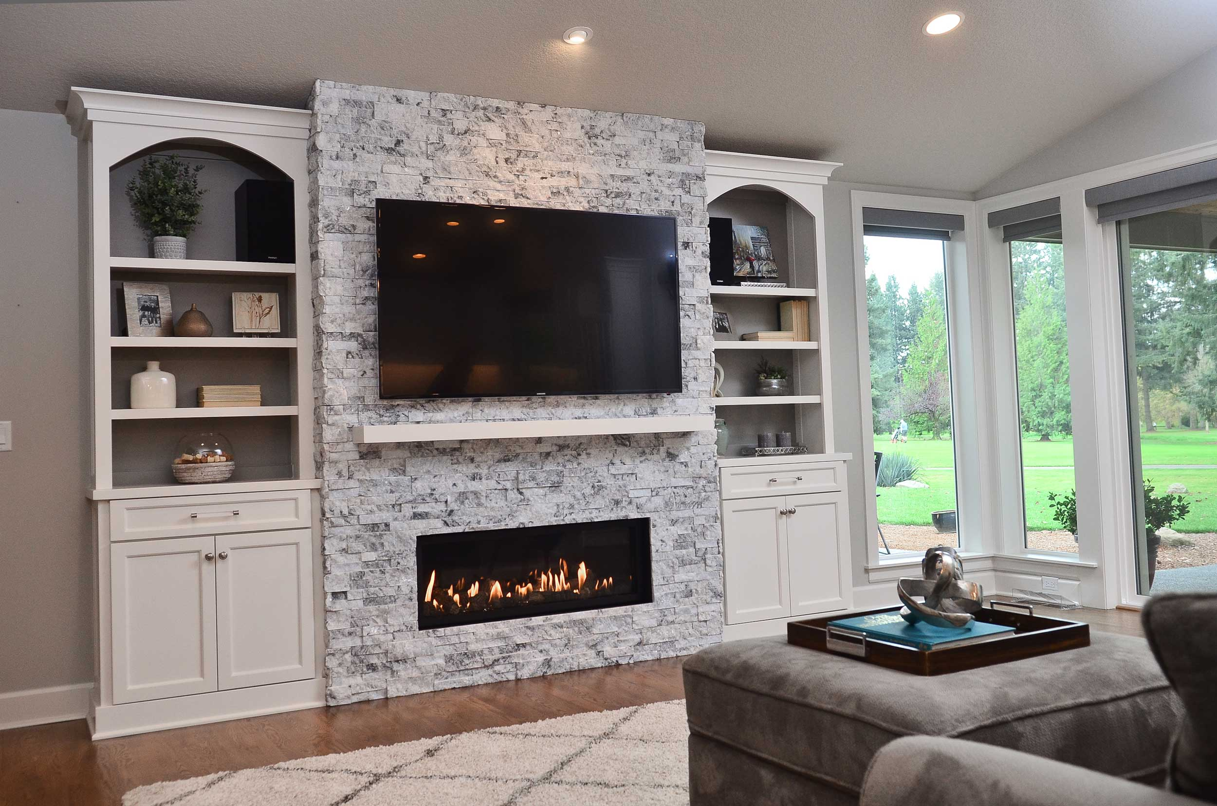 Media wall with built-in bookshelves and TV and fireplace.